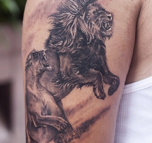 Grey Ink Animal Tattoos On Biceps