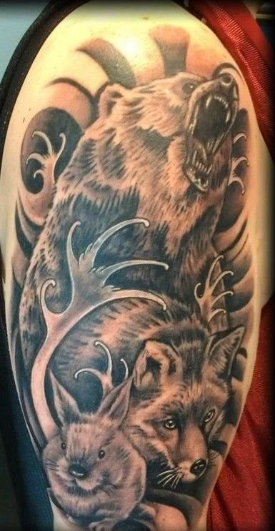 Grey Ink Animals And Wave Tattoos On Sleeve
