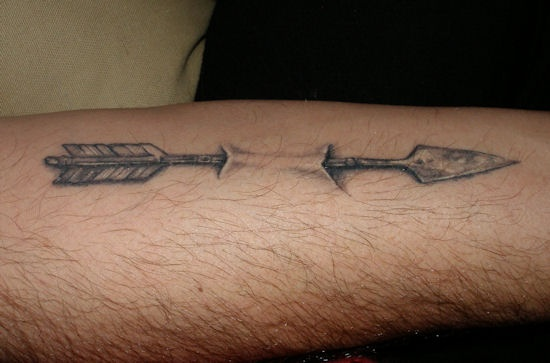 Grey Ink Arrow Through Skin Tattoo