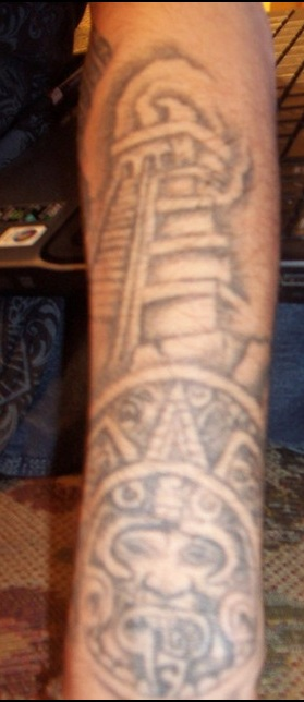 Grey Ink Aztec Pyramid Tattoo On Arm