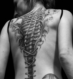 Grey Ink Biomechanical Bone Tattoo
