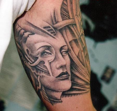 Grey Ink Biomechanical Queen Tattoo On Biceps