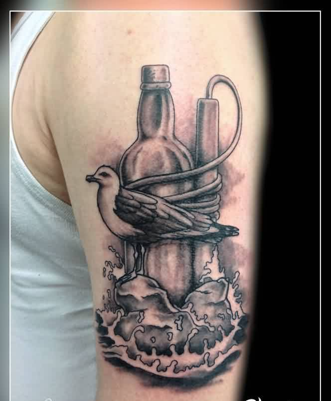 Grey Ink Bottle And Bird Tattoos On Biceps