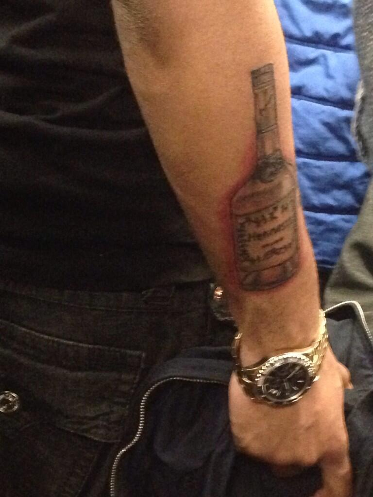 Grey Ink Bottle Tattoo On Lower Arm
