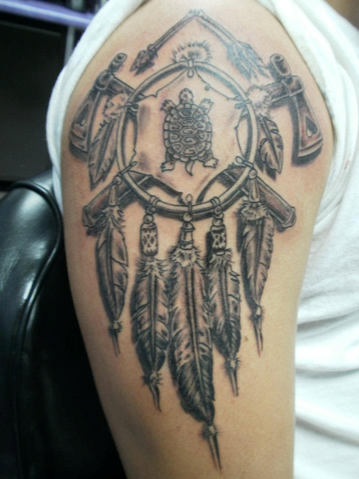 Grey Ink Broken Arrow And Dreamcatcher Tattoos On Arm