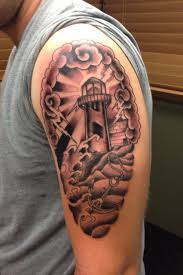 Grey Ink Clouds And Lighthouse Tattoos On Biceps