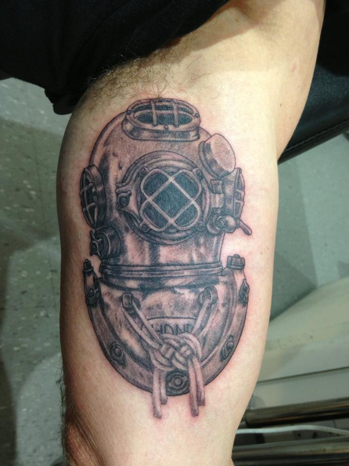 Grey Ink Diving Helmet Tattoo On Inner Muscles