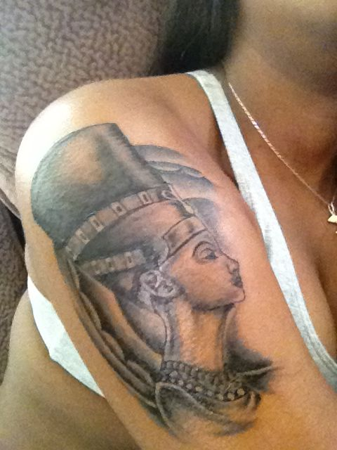 Grey Ink Egyptian Queen Portrait Tattoo On Biceps