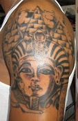 Grey Ink Egyptian Queen Tattoo On Shoulder