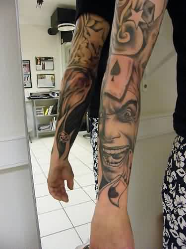 Grey Ink Evil Portrait Tattoo On Left Wrist