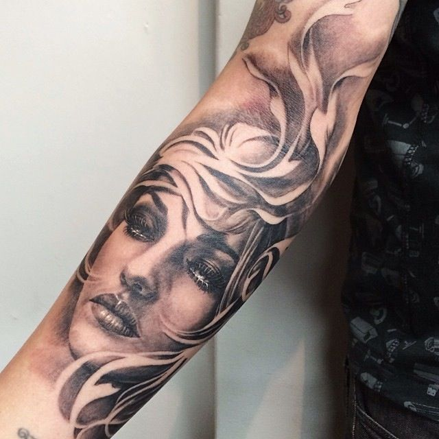 Grey Ink Female Portrait Tattoo On Forearm (2)