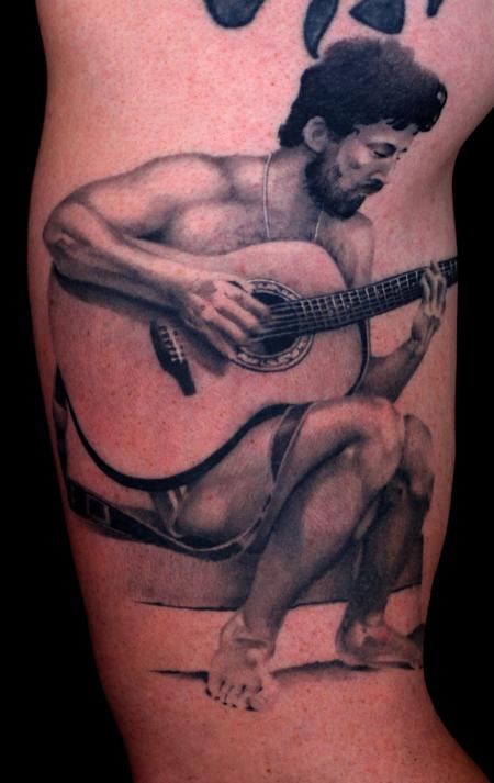 Grey Ink Guitarist Portrait Tattoo On Muscles