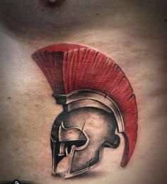 Grey Ink Helmet With Red Hairs Tattoo