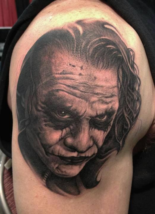 Grey Ink Joker Portrait Tattoo On Shoulder
