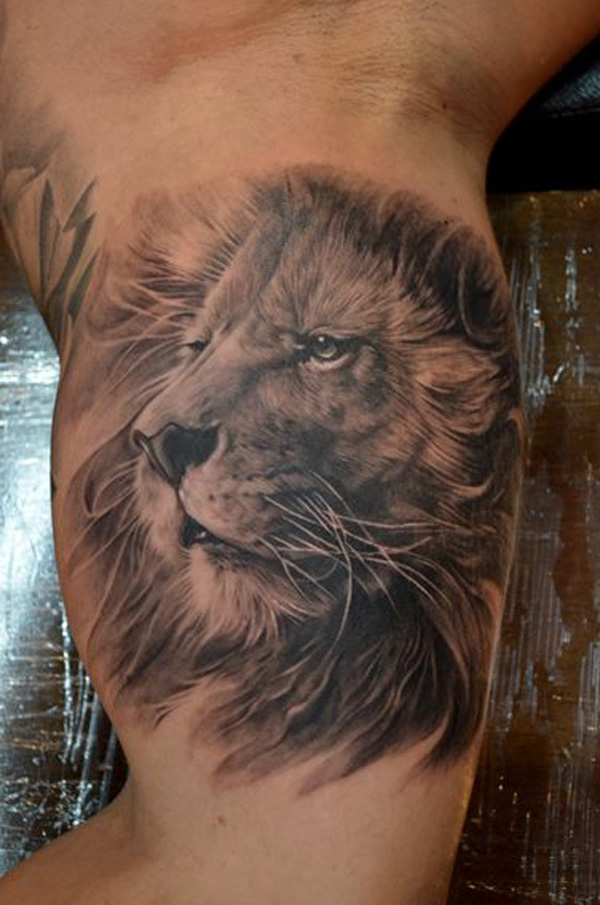 Grey Ink Lion Face Tattoo On Inner Muscles
