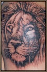 Grey Ink Lion Face Tattoo Photo