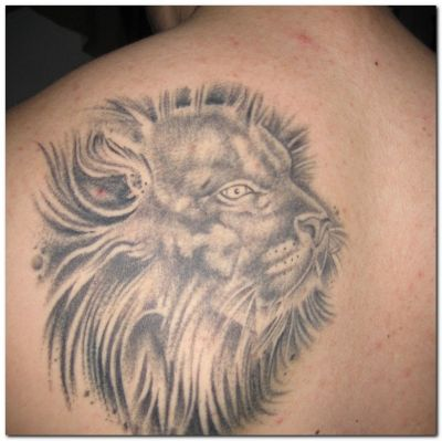 Grey Ink Lion Head Tattoo
