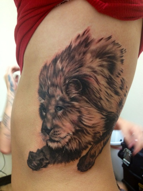 Grey Ink Lion Tattoo On Ribs