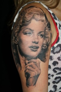 Grey Ink Marilyn Monroe Portrait Tattoo On Shoulder