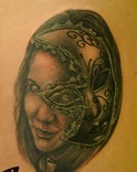 Grey Ink Masked Girl Portrait Tattoo