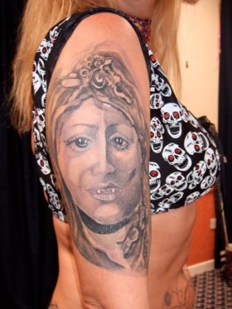 Grey Ink Medusa Portrait Tattoo On Right Arm
