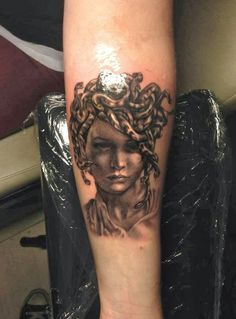 Grey Ink Medusa Portrait Tattoo