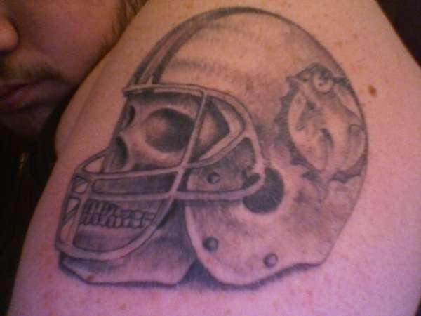 Grey Ink Miami Dolphin Helmet Tattoo On Shoulder