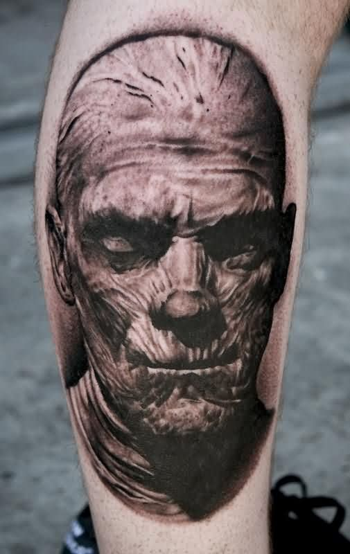 Grey Ink Mummy Portrait Tattoo On Leg