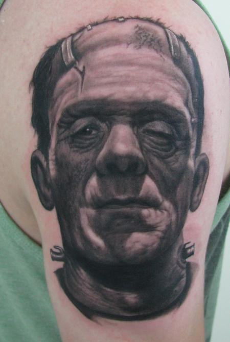 Grey Ink Portrait Tattoo On Biceps (2)