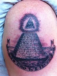 Grey Ink Pyramid And Banner Tattoos On Biceps