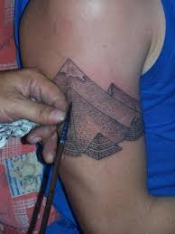 Grey Ink Pyramid Tattoo On Biceps