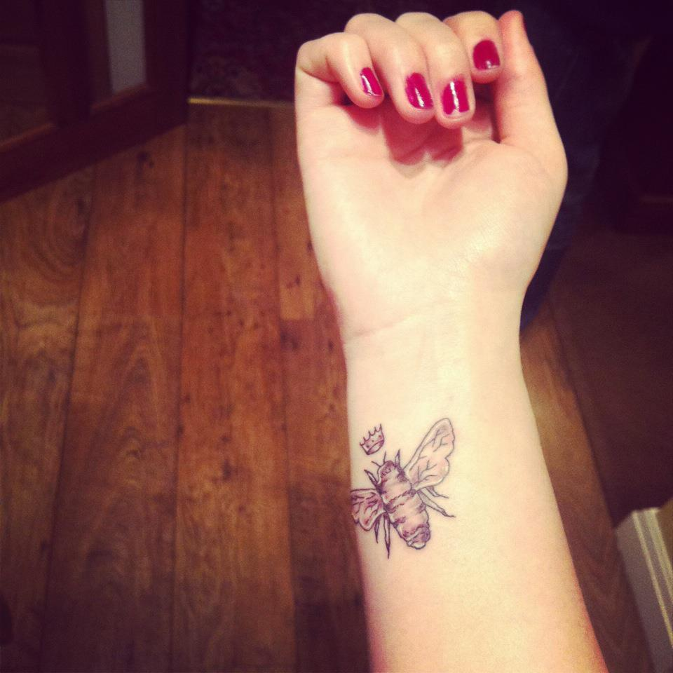 Grey Ink Queen Bee Tattoo On Inner Wrist