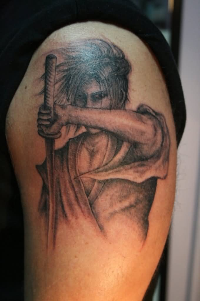 Grey Ink Samurai Sword Portrait Tattoo On Shoulder