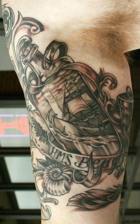 Grey Ink Ship In Bottle Tattoo On Muscles