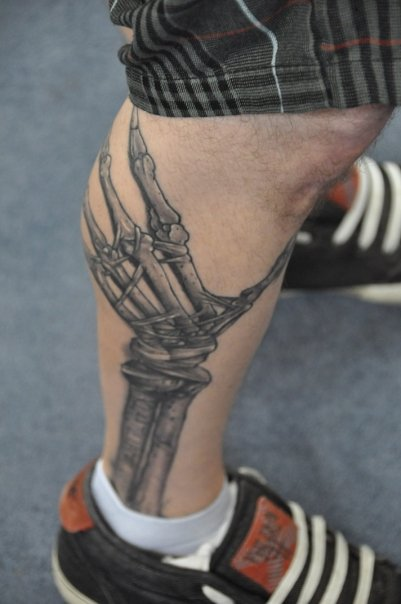 Grey Ink Skeleton Hand Bones Tattoo On Leg
