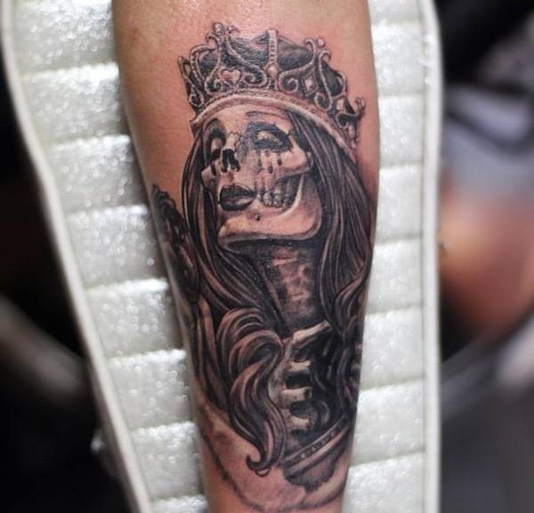Grey Ink Skull Queen Tattoo On Arm