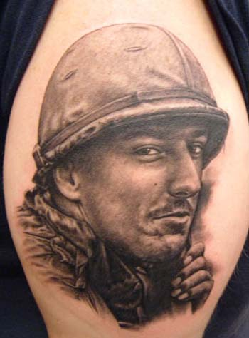 Grey Ink Soldier Portrait Tattoo On Biceps