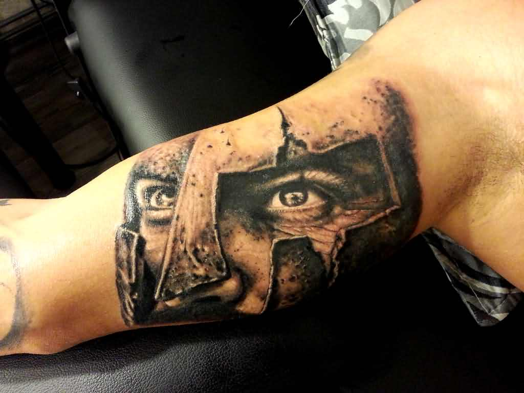 Grey Ink Spartan Head Portrait Tattoo On Muscles