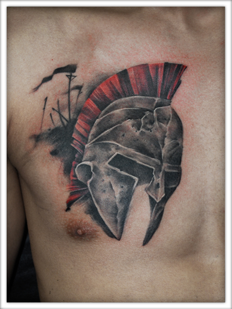 Grey Ink Stone Helmet And Hairs Tattoo On Chest