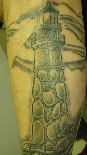Grey Ink Stone Lighthouse Tattoo