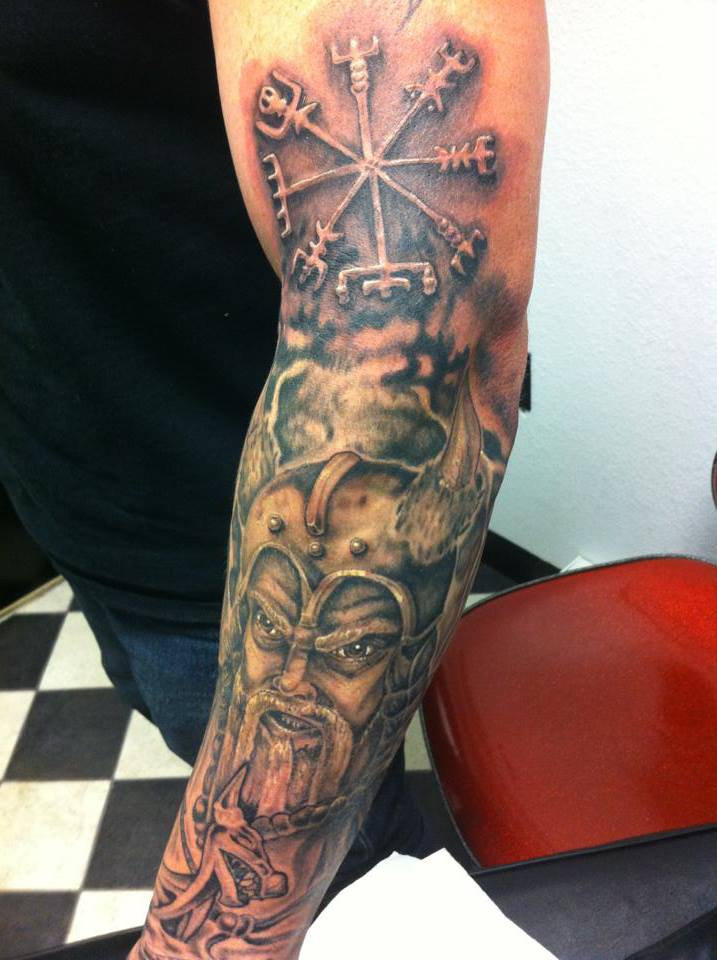 Grey Ink Viking Portrait Tattoo On Sleeve