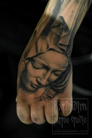 Grey Ink Virgin Mary Portrait Tattoo On Hand