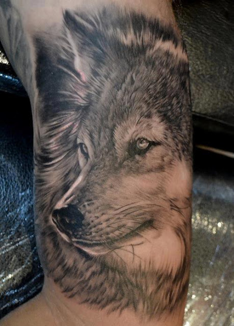 Grey Ink Wolf Face Tattoo On Inner Arm