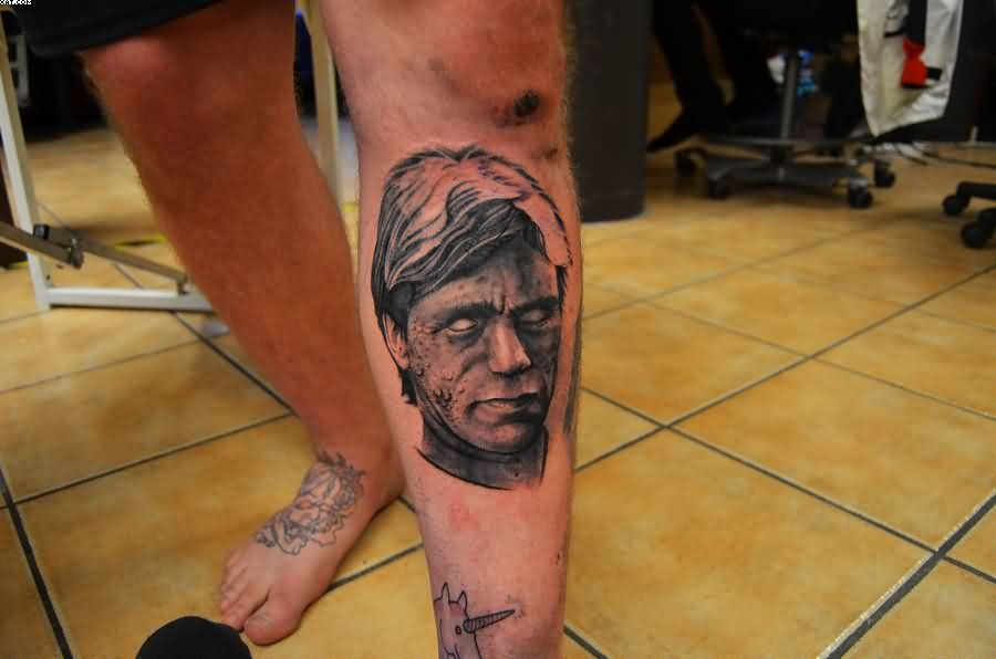 Grey Ink Zombie Face Portrait Tattoo On Left Leg