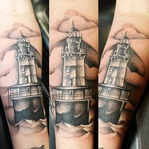 Grey Lighthouse Tattoo On Forearm