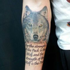 Grey Wolf Head And Lettering Tattoos On Forearm