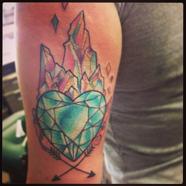 Heart And Crossed Arrow Tattoo