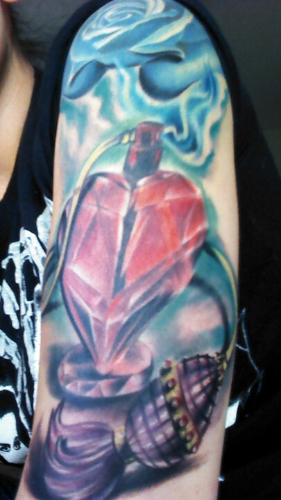 Heart Shape Perfume Bottle Tattoo On Arm