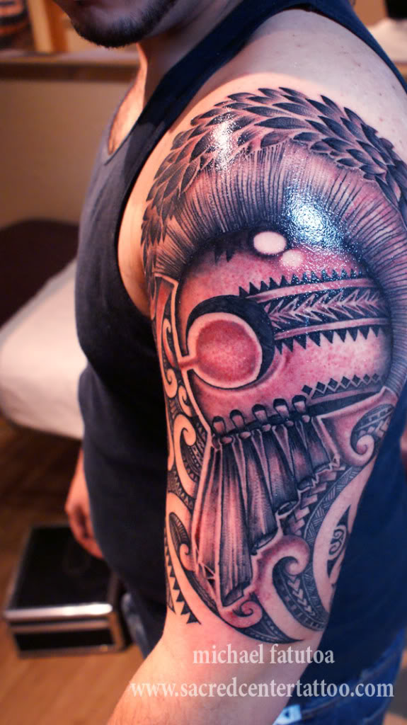 Helmet And Polynesian Tattoos On Half Sleeve