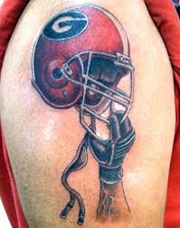 Helmet In Hand Tattoo On Muscles